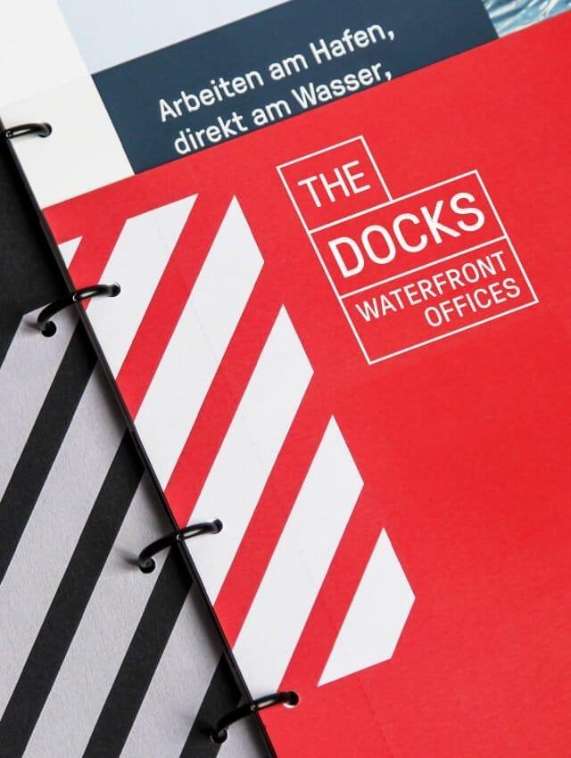 acre Immobilienmarketing Büro konzipiert Vermaktungsmappe für The Docks Frankfurt