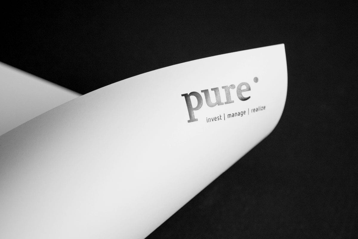 Logo and claim of pure AG on stationery